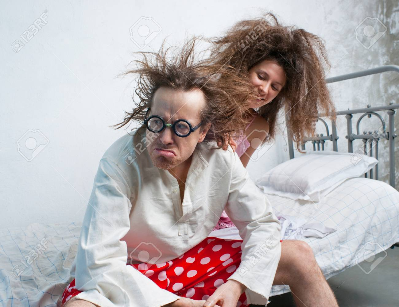 Funny Husband And Wife In The Bed