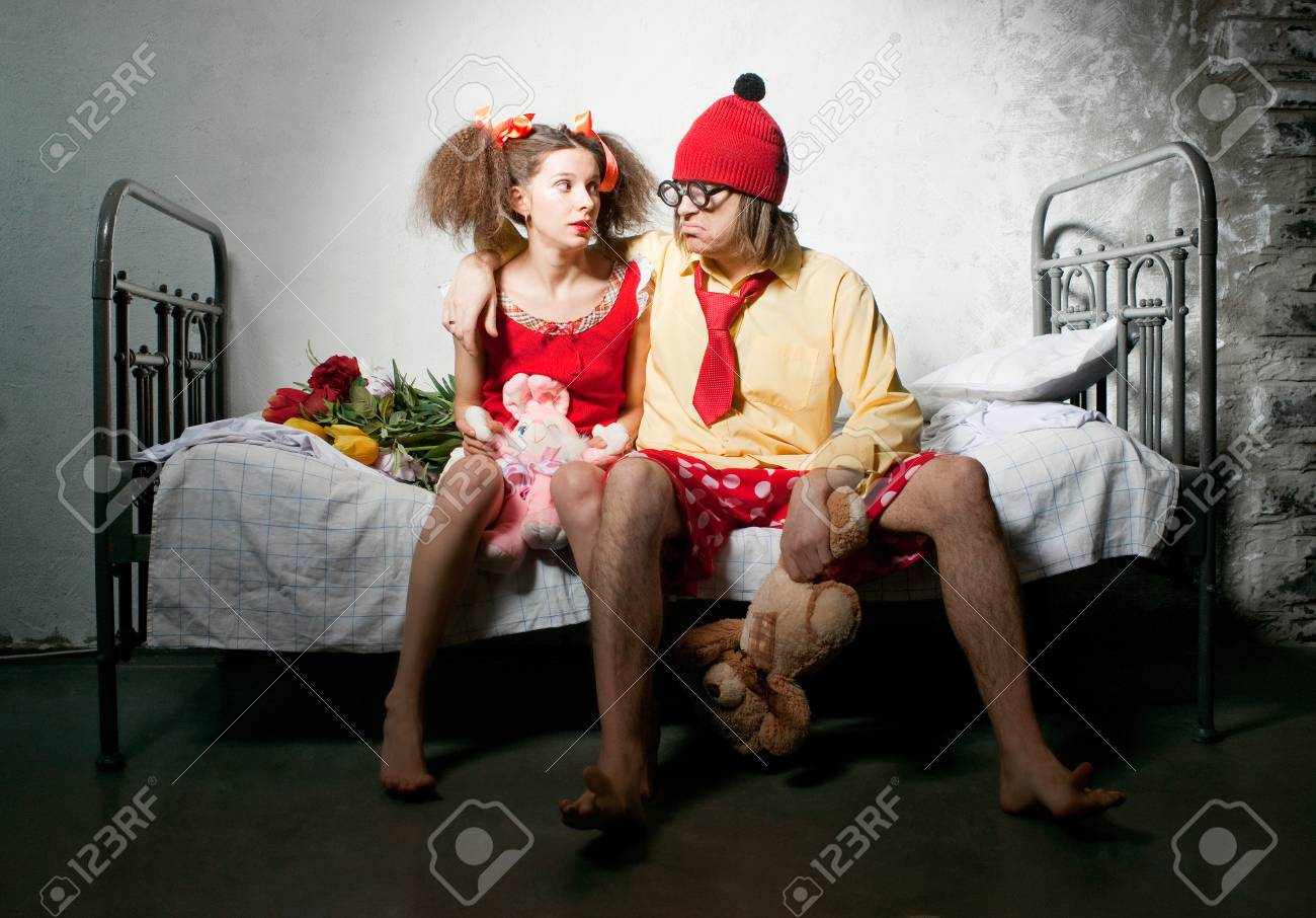 Funny couple sitting on the bed Stock Photo - 25834994