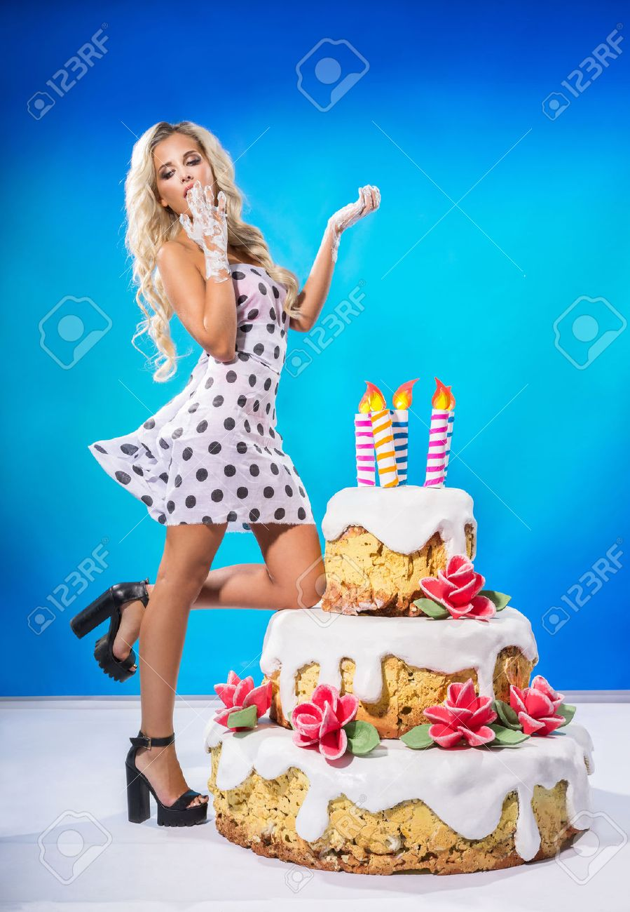 Sexy Young Woman Eating A Big Birthday Cake Stock Photo