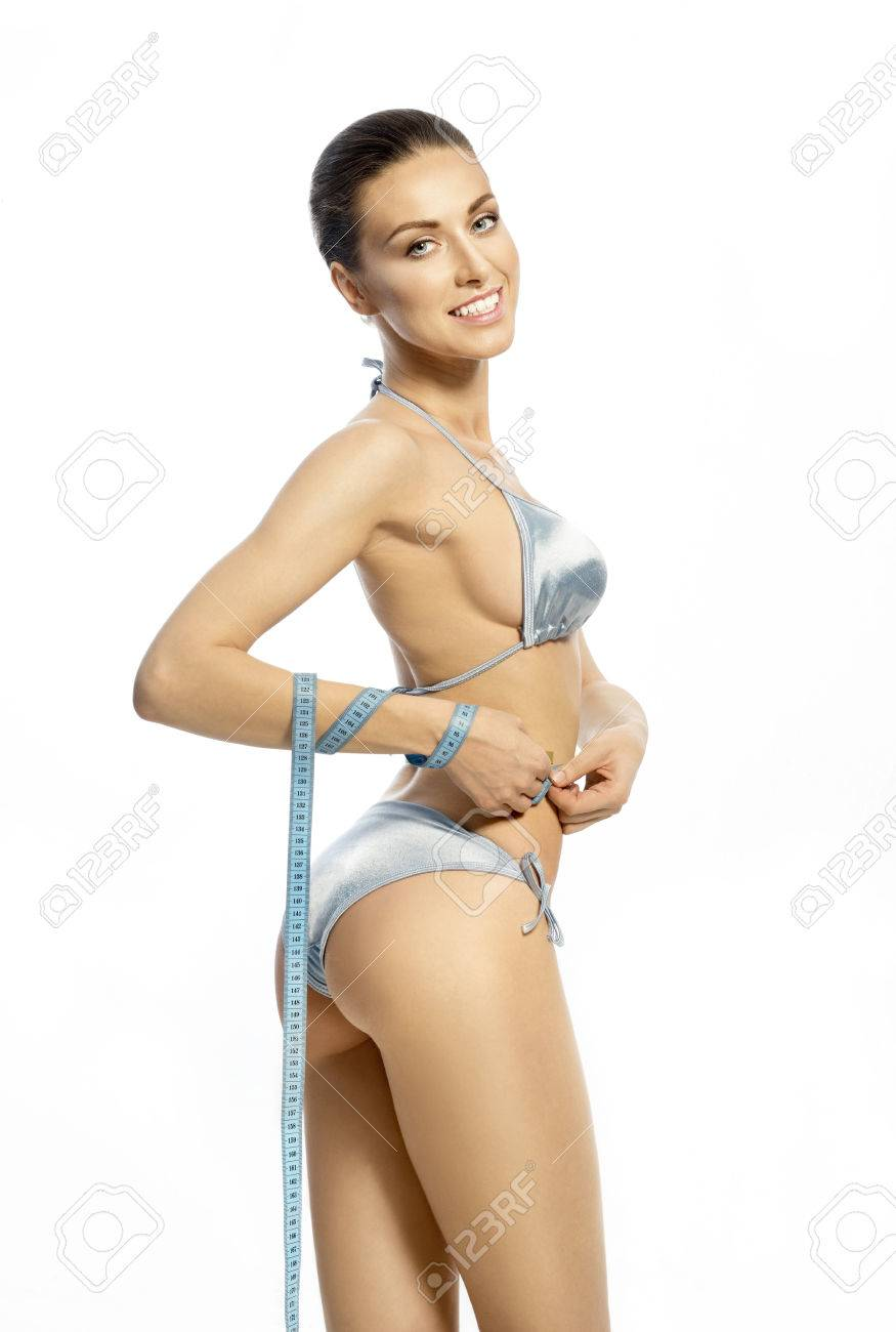 81f693a27b9f2 Slender woman in a blue lingerie with a tape-measure on the small waist  Stock