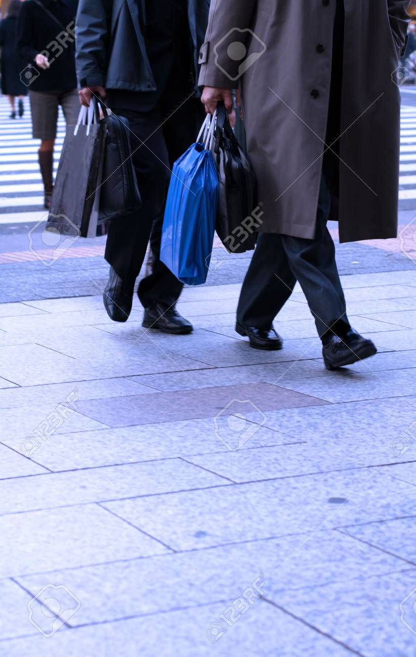 Businessmen shopping in a big city-abstract urban image. Stock Photo - 718919