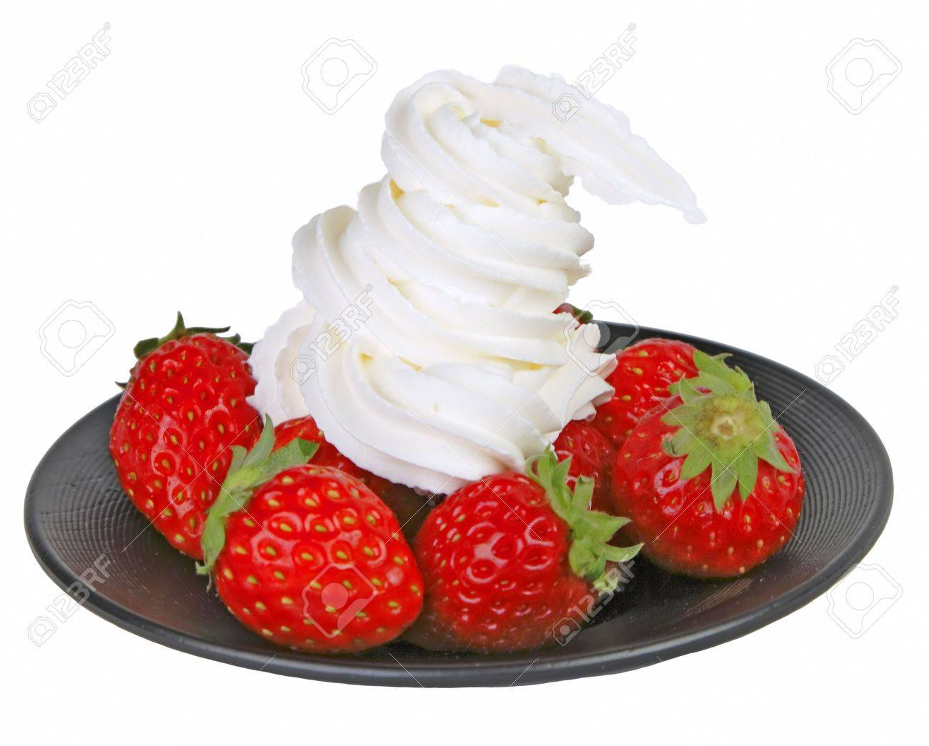Black plate with strawberries with whipped cream isolated over white background Stock Photo - 759381