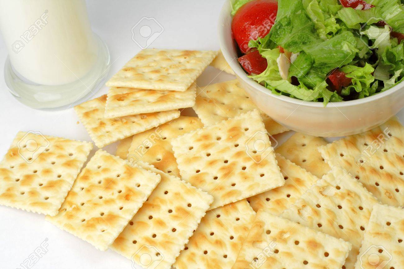 Crackers,vegetable salad and a glass of milk can be a very good choice for a healthy low calories breakfast. Stock Photo - 1201986