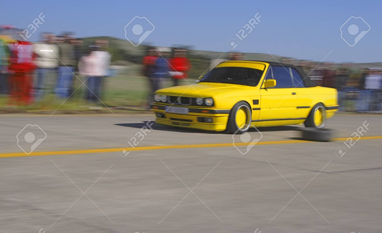 Panning image of a speedy car during a legal street race. Stock Photo - 1585479
