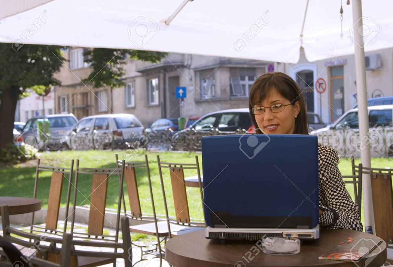 Image of a businesswoman working on a laptop at a terrace Stock Photo - 1779999