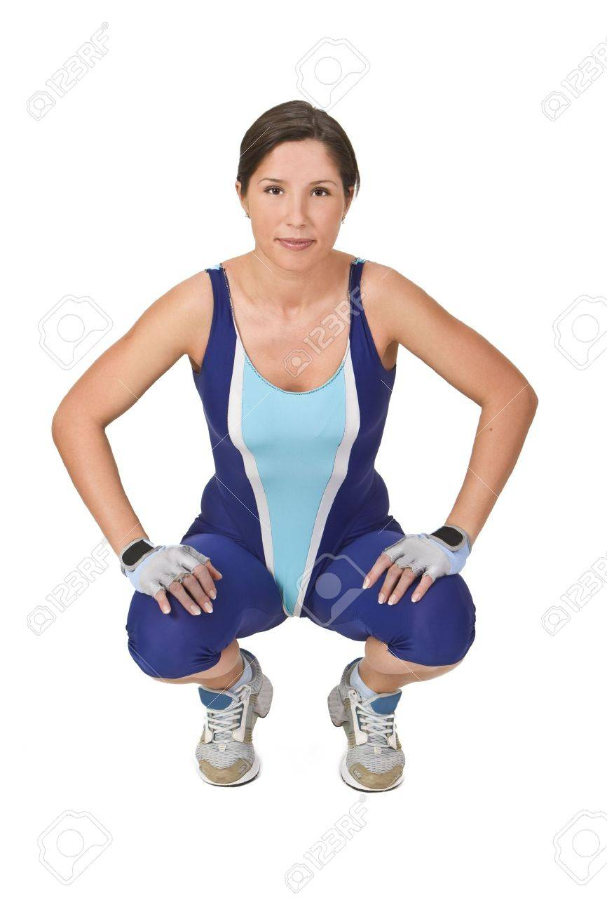 Fitness girl squatting on her haunches and relaxing. Stock Photo - 2428549