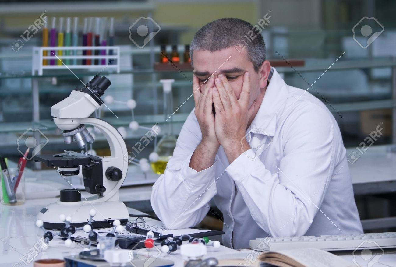 Tired researcher at his workplace. Stock Photo - 3287704