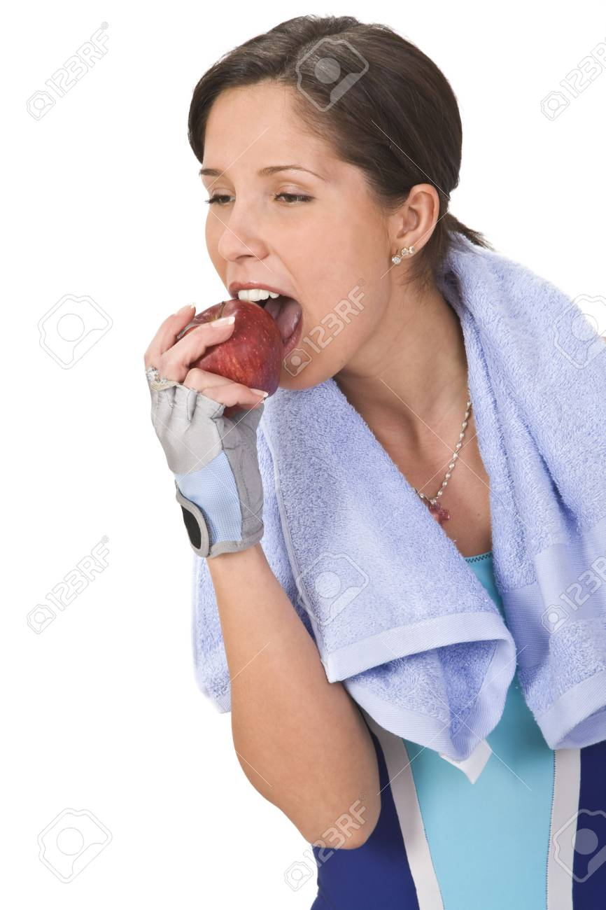 Young woman bitting a red apple Stock Photo - 3649230