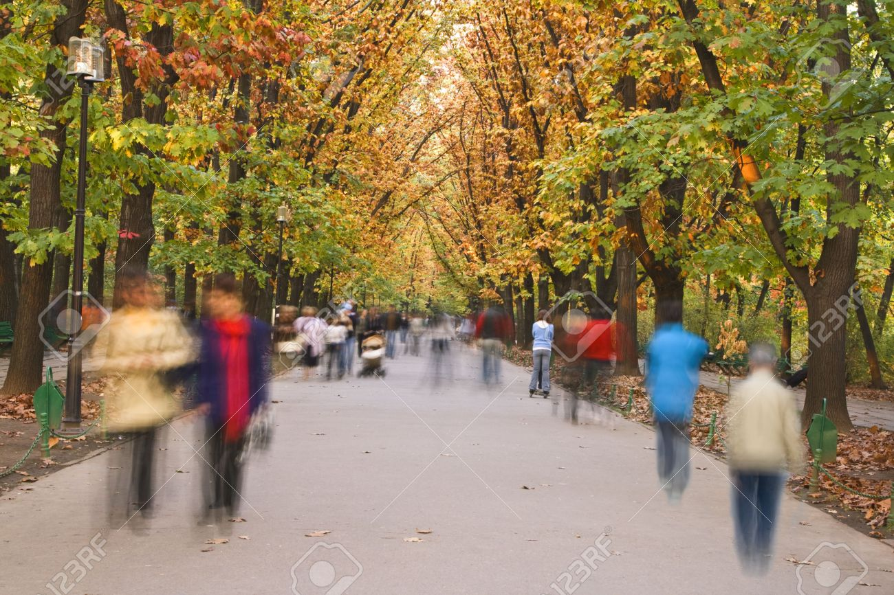 Blurred image of people walking in an autumn park. Stock Photo - 3869332