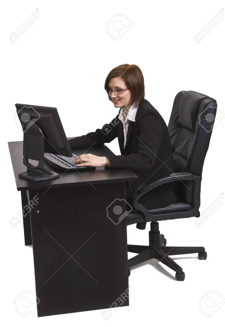 Businesswoman working on a computer at her desk. Stock Photo - 3904734
