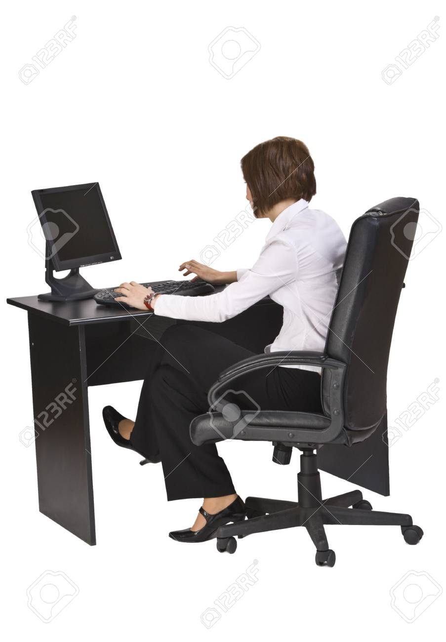 Young businesswoman at her desk working on the computer. Stock Photo - 3913304