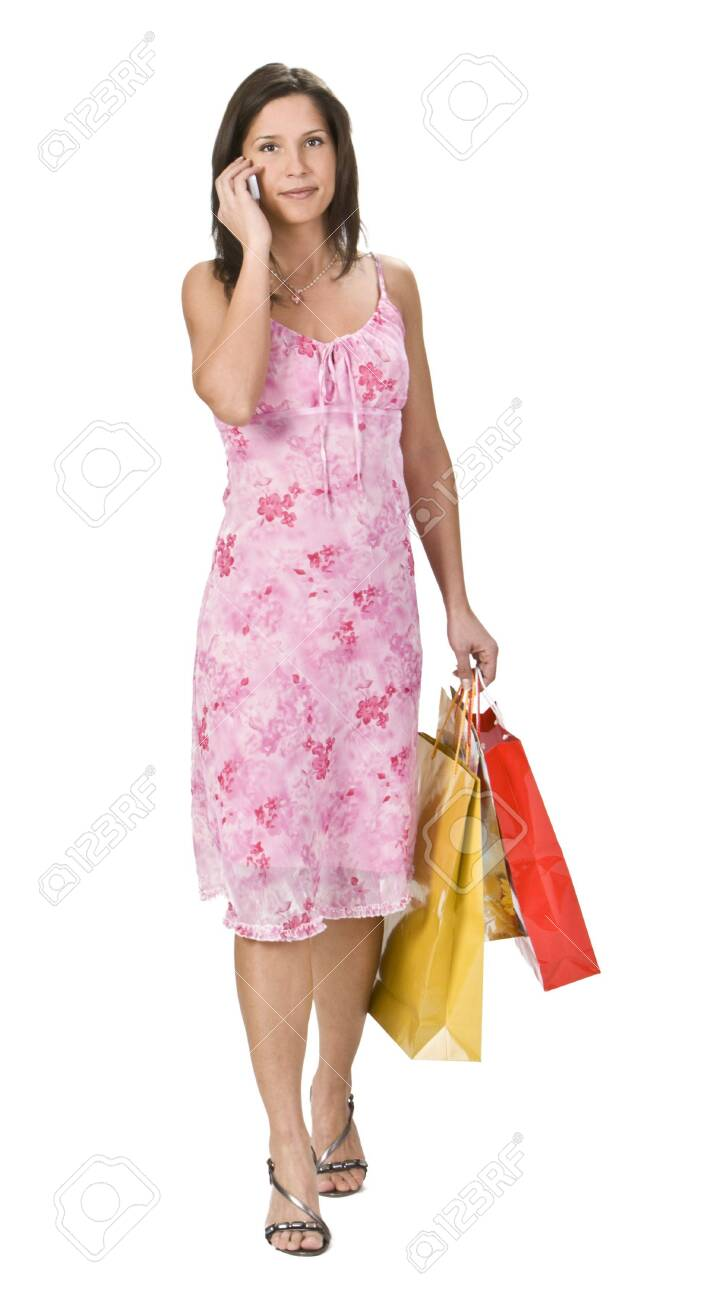 Young woman with shopping bags using a mobile phone. Stock Photo - 4091611