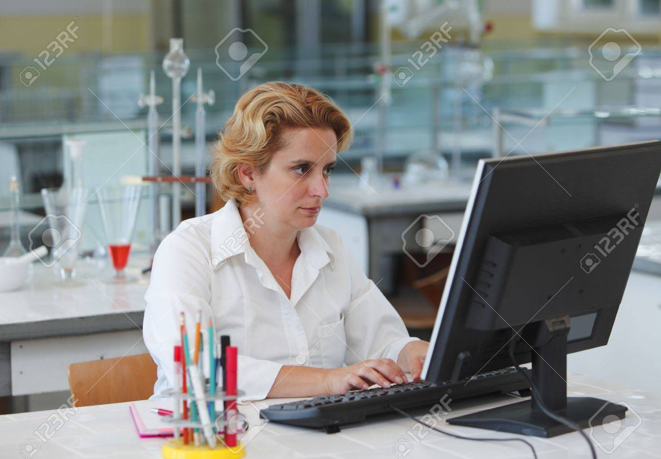 Female researcher working on a computer in a laboratory. Stock Photo - 5845074