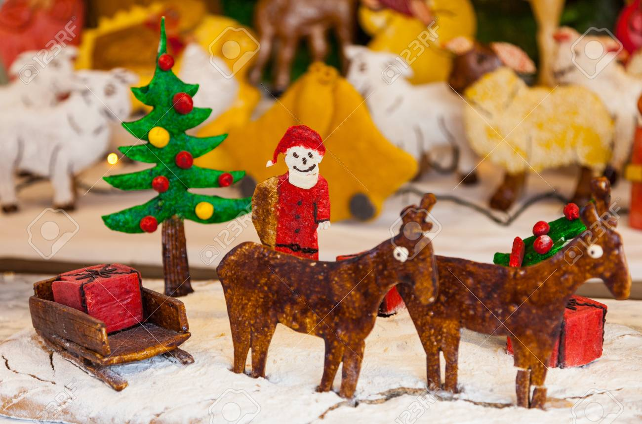 A funny Cristmas scene with figurines made by ginger bread. Stock Photo - 16675129
