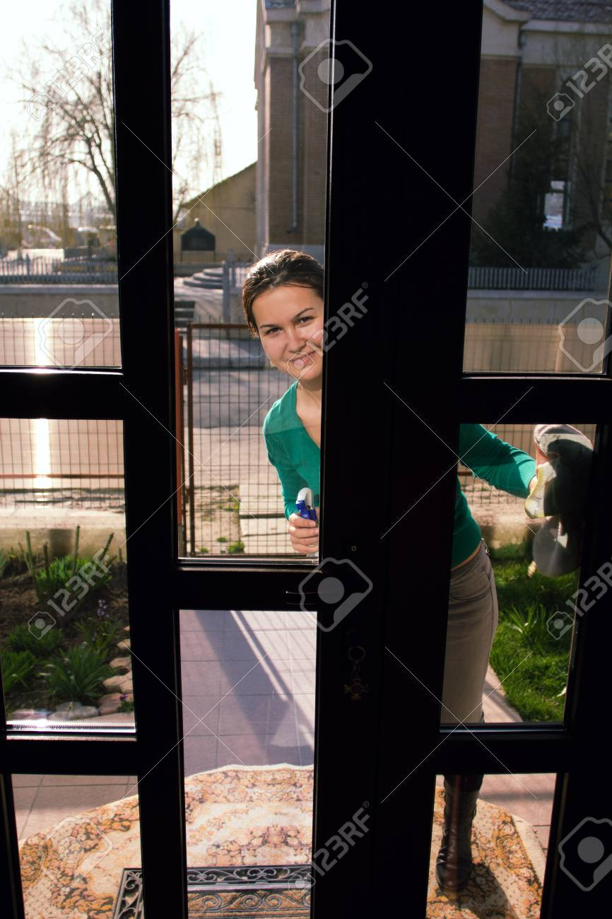 Housewife Looking Through Glass Door Stock Photo Picture And