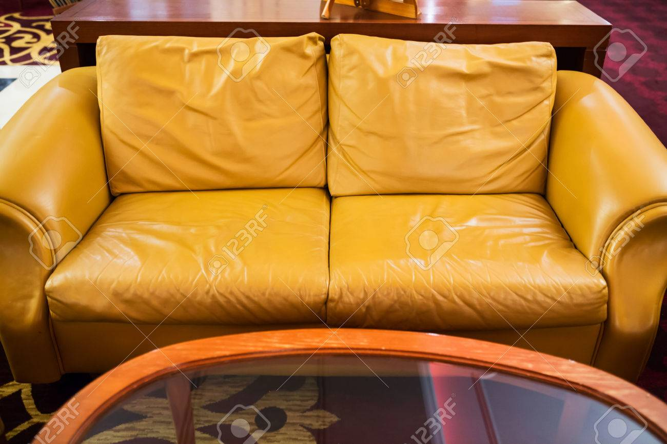 Stock photo yellow leather sofa placed in a hotel lobby