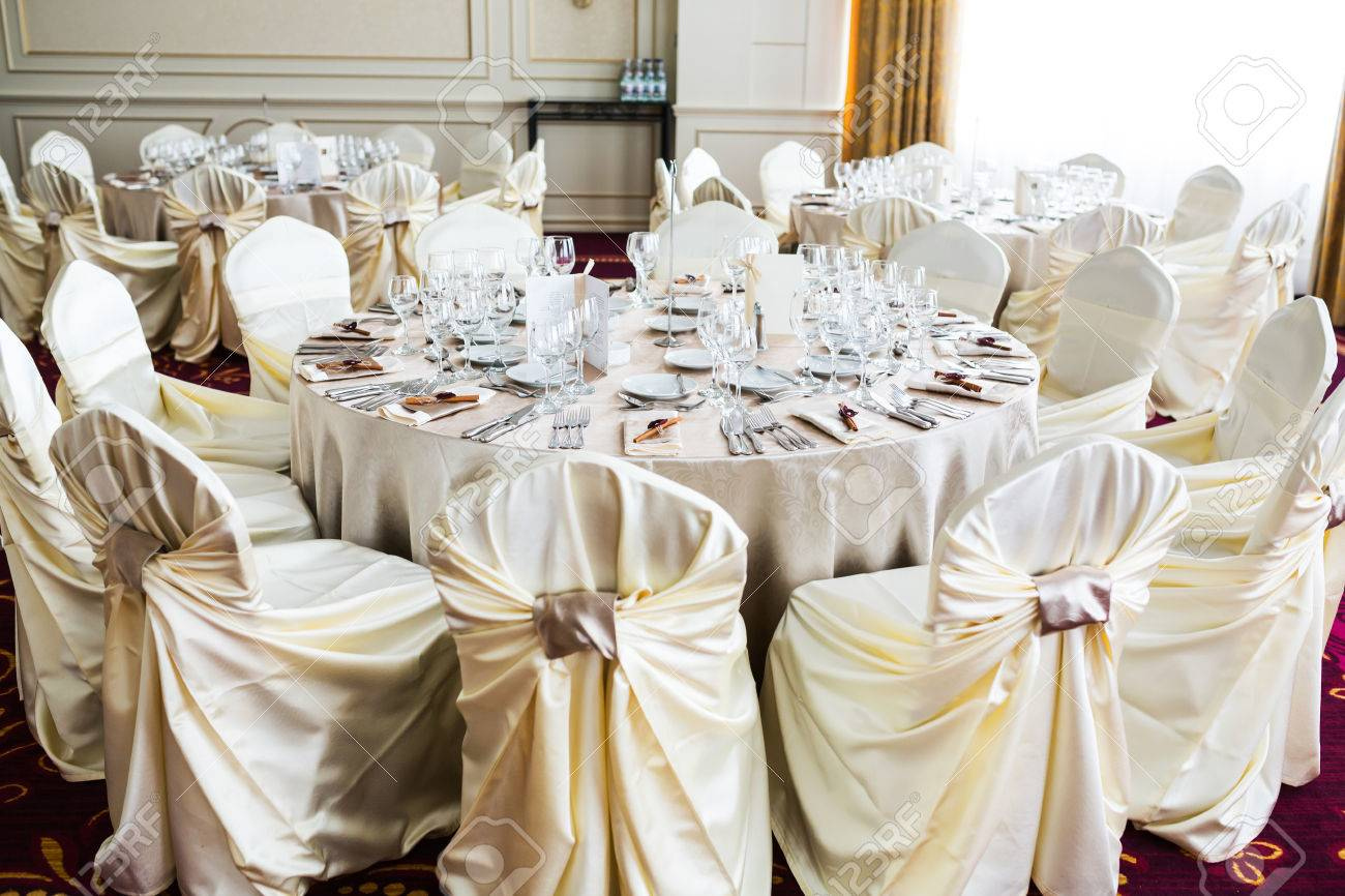romantic wedding setting inside a restaurant with beige chair