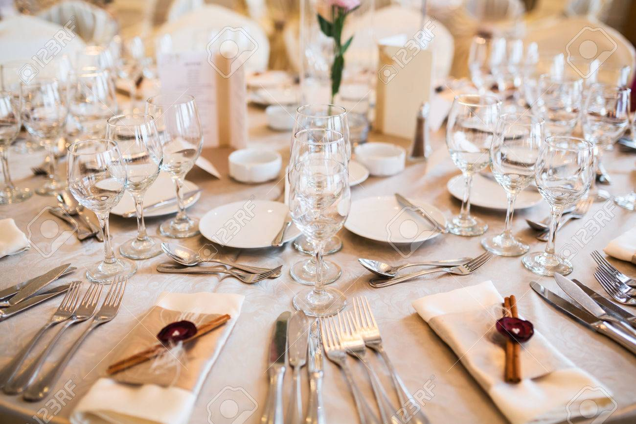 romantic wedding table arrangement with beige tablecloth and stock