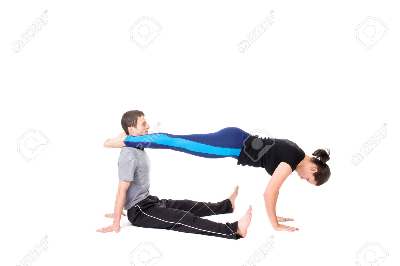 Two Active People Doing Stretching Yoga Exercise