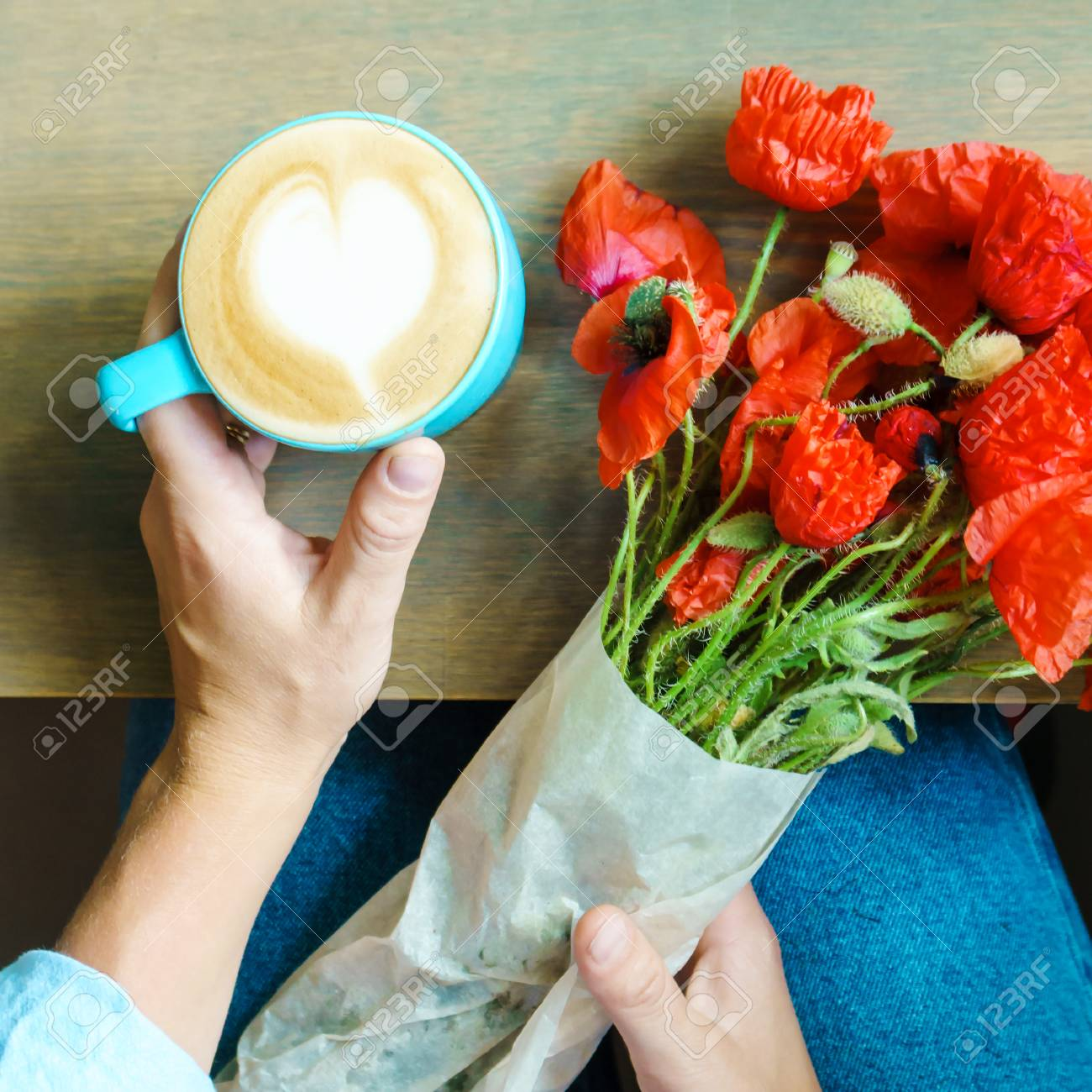 Bouquet Of Poppy Flowers And A Cup Of Cappuccino In Woman Hands