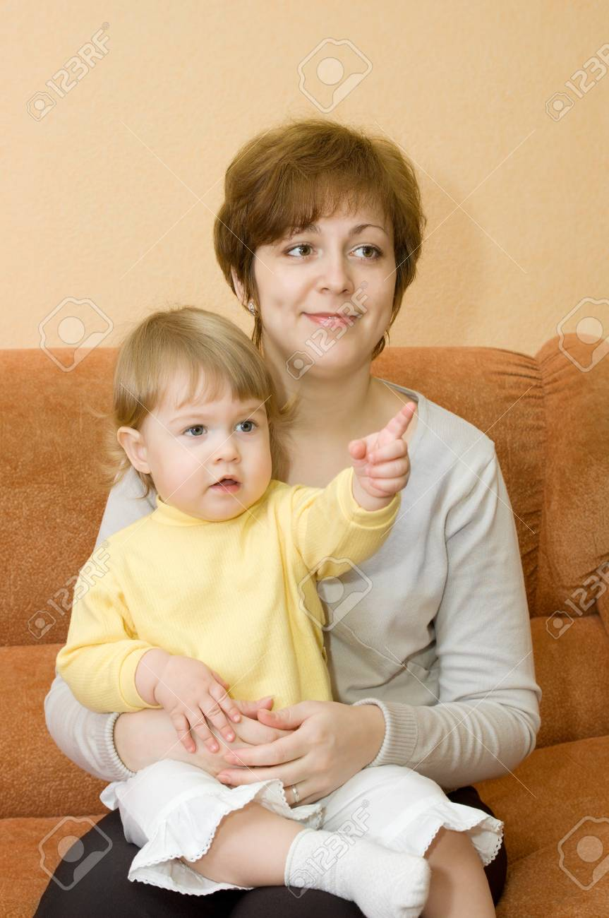Small baby and mother on armchair in home Stock Photo - 4355837