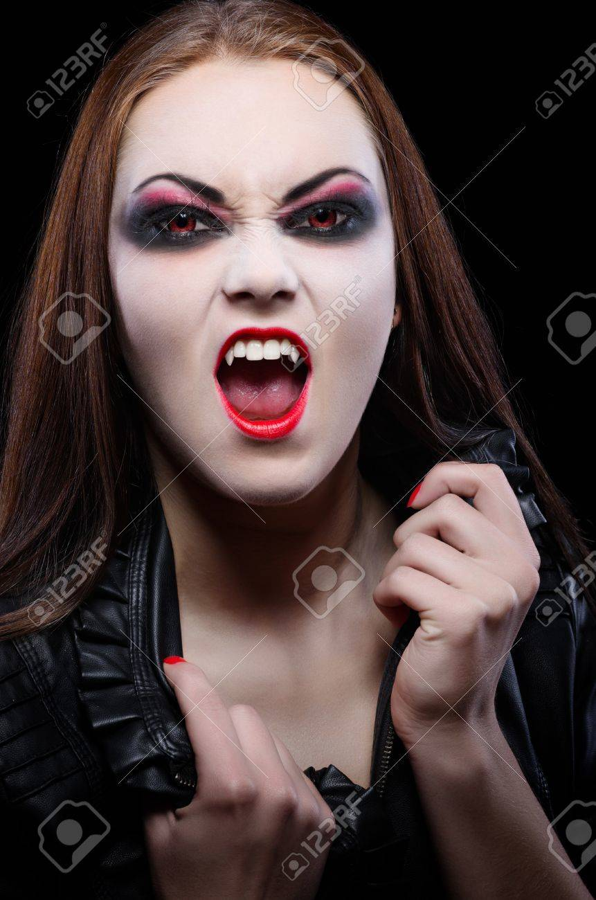 Young beautiful vampire woman isolated Stock Photo - 15452037