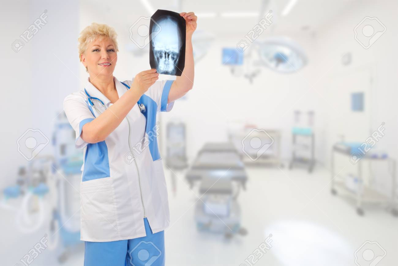 mature doctor with x-ray at medical office stock photo, picture and