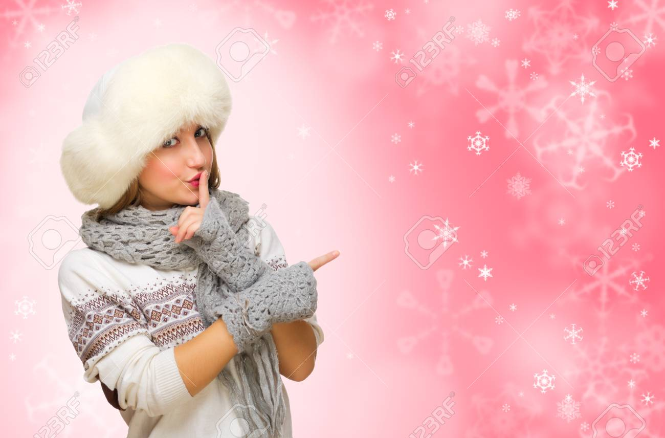 Young girl in fur hat on red snowy background Stock Photo - 22036546