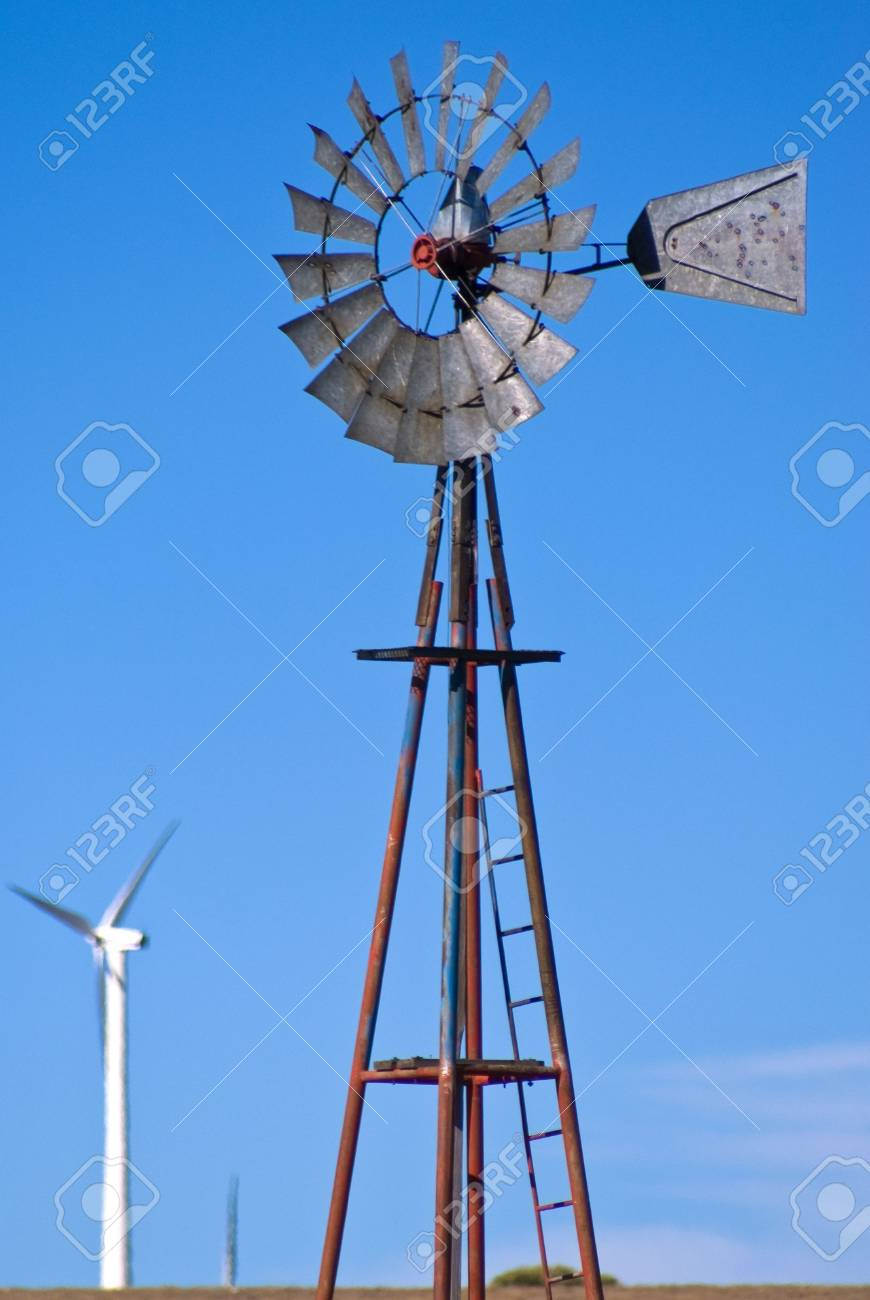 Water windmill surrounded by wind turbine generators Stock Photo - 3815327