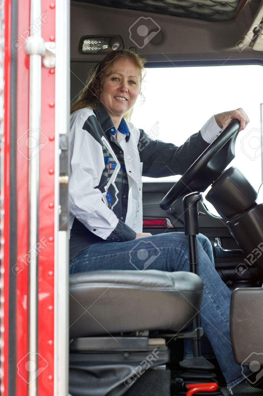 View of woman truck driver from the passenger side of the truck. Stock Photo - 3953253