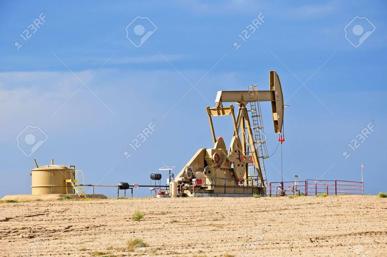 Crude Oil Pump Jack Against a Blue Sky Stock Photo - 14838170