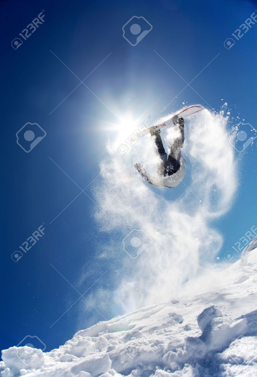 Snowboarder launching off a jump; La Thuile , Aosta, Italy. Stock Photo - 2778972