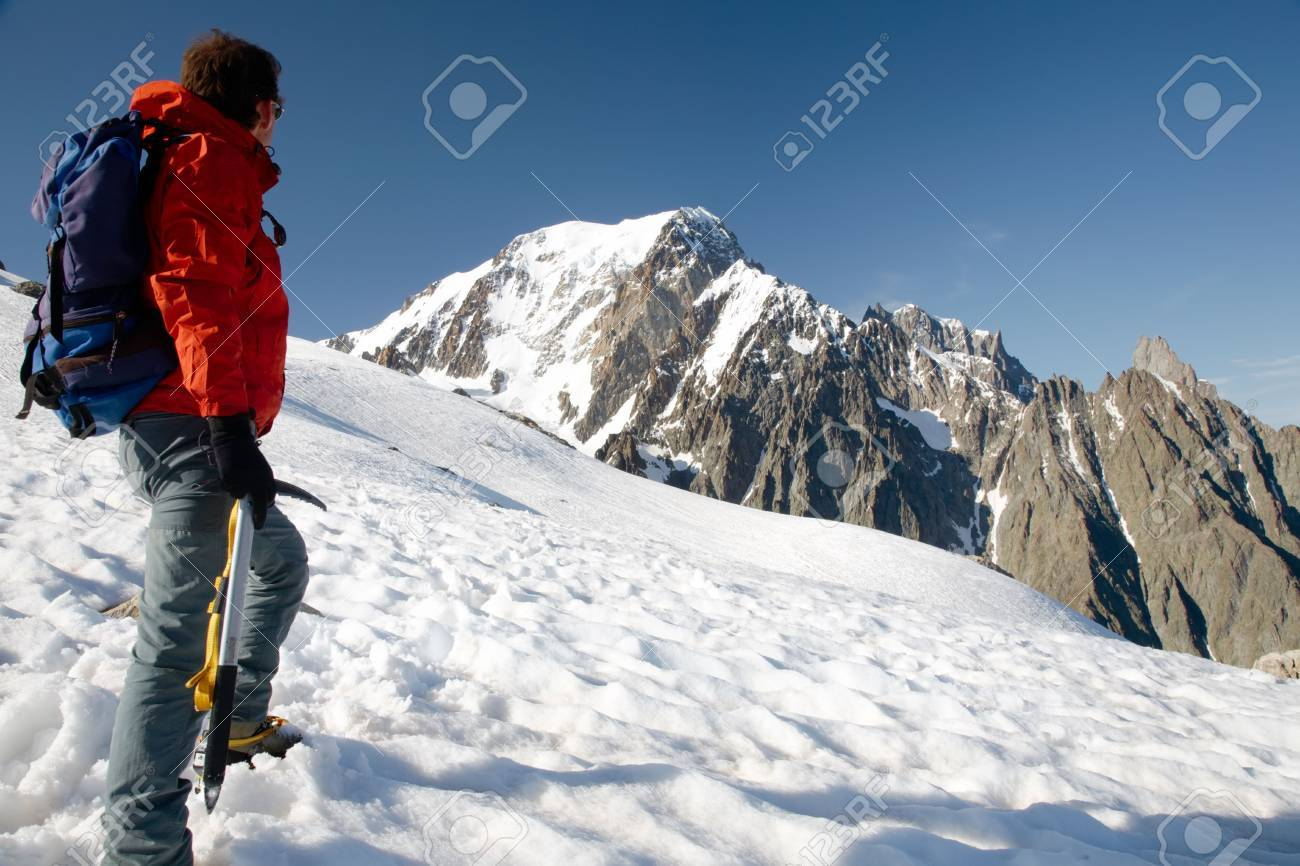Male young climber standing in front of south side of Mont Blanc; Italy - France Stock Photo - 3342854