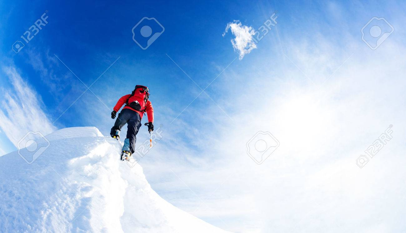 Mountaineer arrive at the summit of a snowy peak. Concepts: determination, courage, effort, self-realization. Sunny winter day, european Alps. - 50878346