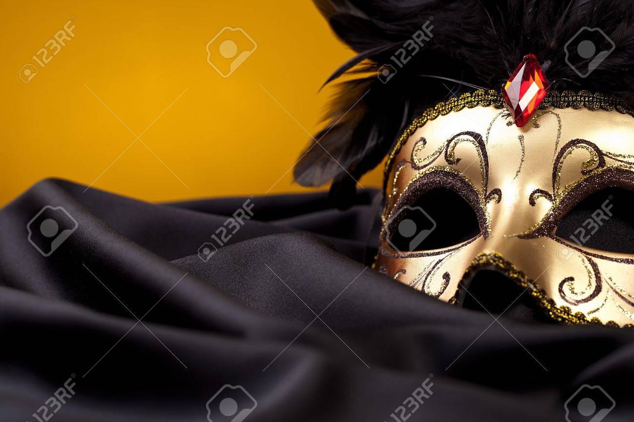 gold mask on black silk Stock Photo - 11337437