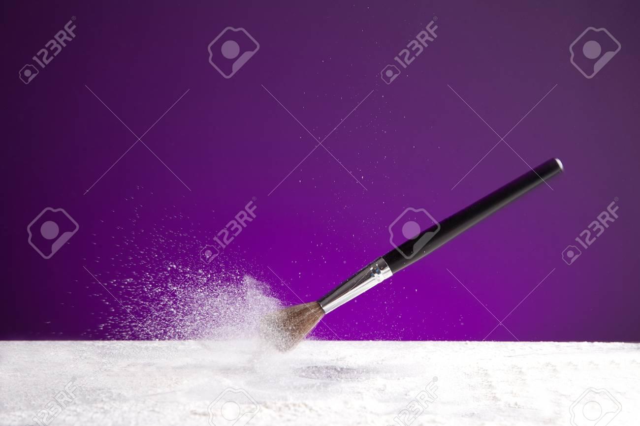 powderbrush on purple background Stock Photo - 11588428