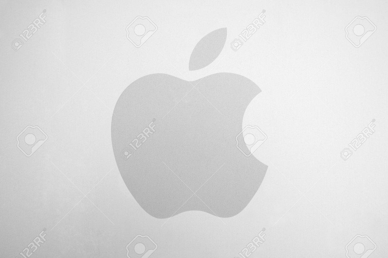 apple logo white background. aachen, germany february, 2017: white apple logo on brushed aluminum background. background
