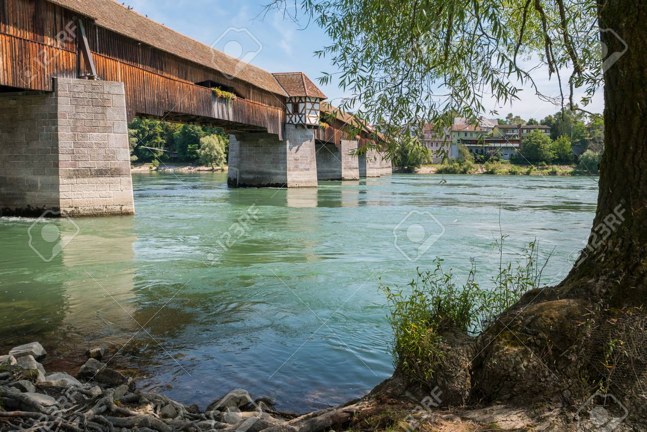 Stock Photo   View Of The Oldest Wooden Historic Border Bridge Over Rhine  River And View To Switzerland In Bad Saeckingen At Summer, Black Forest, ...