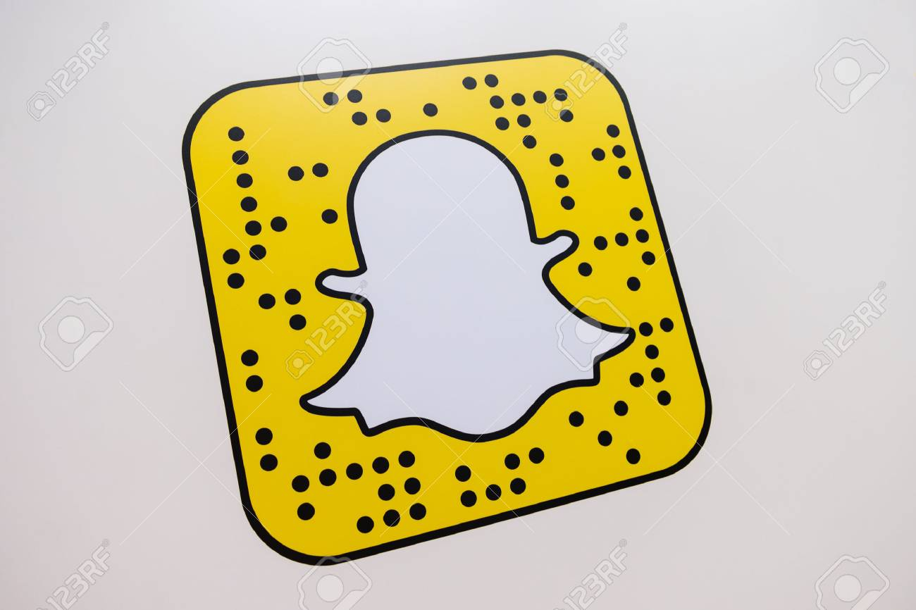 COLOGNE, GERMANY SEPTEMBER, 2017: Snapchat logo printed on a paper wall. Snapchat is a popular social media application for sharing messages, images and videos. - 86347755