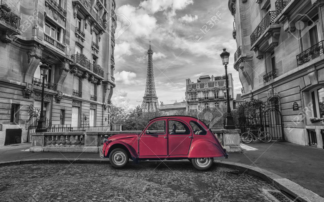 Eiffel tower in Paris and red retro car in black and white color key - 90104568