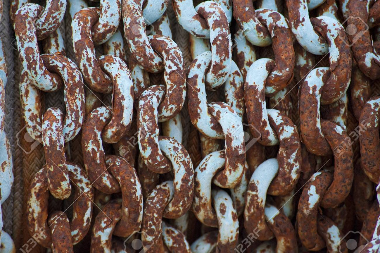 Rusty chain used to haul anchors on fishing boats Stock Photo - 4575073