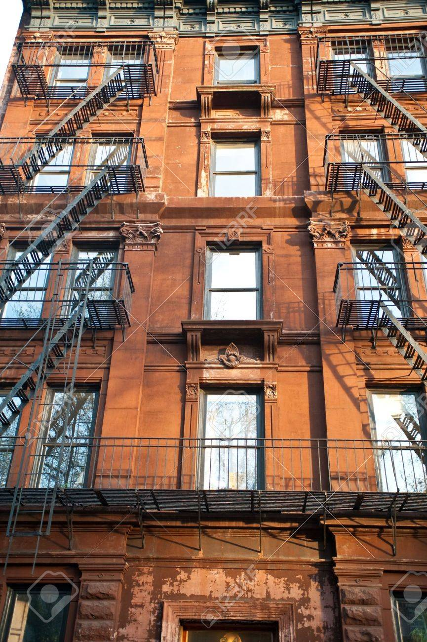Brick Apartment Building Window old brick apartment buildings in a big city. stock photo, picture