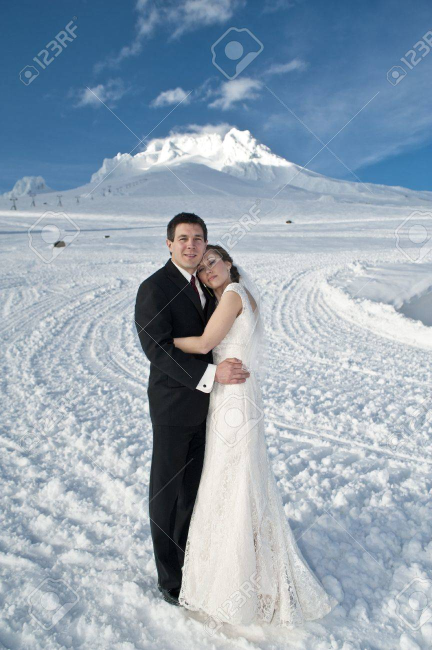 Bride and groom in winter snow on mountain Stock Photo - 17265052