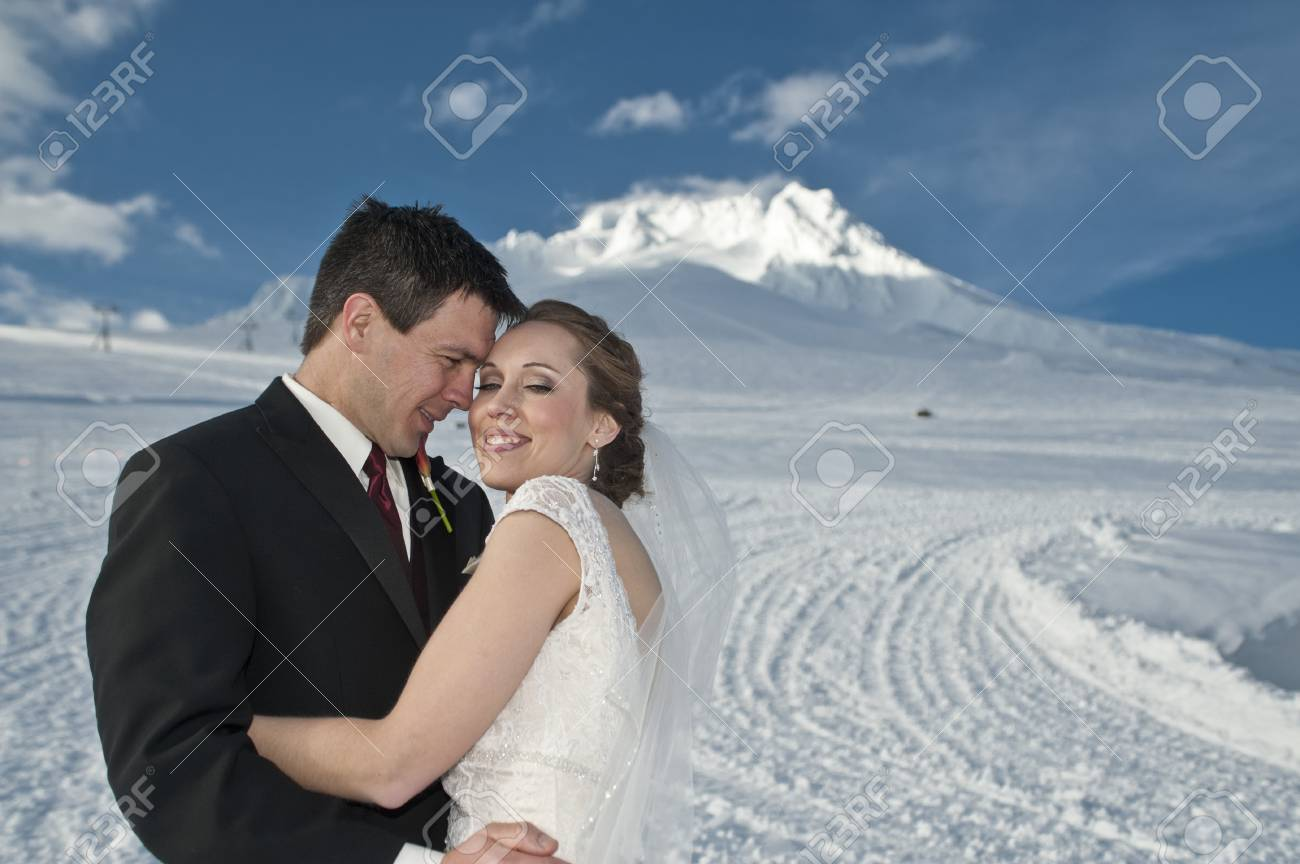 Bride and groom in winter snow on mountain Stock Photo - 17265031