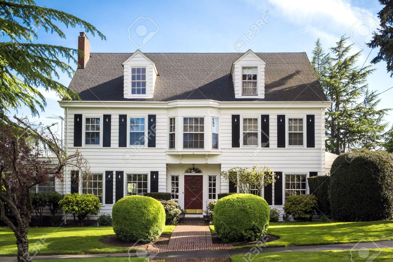 classic american suburban house with blue sky background stock photo