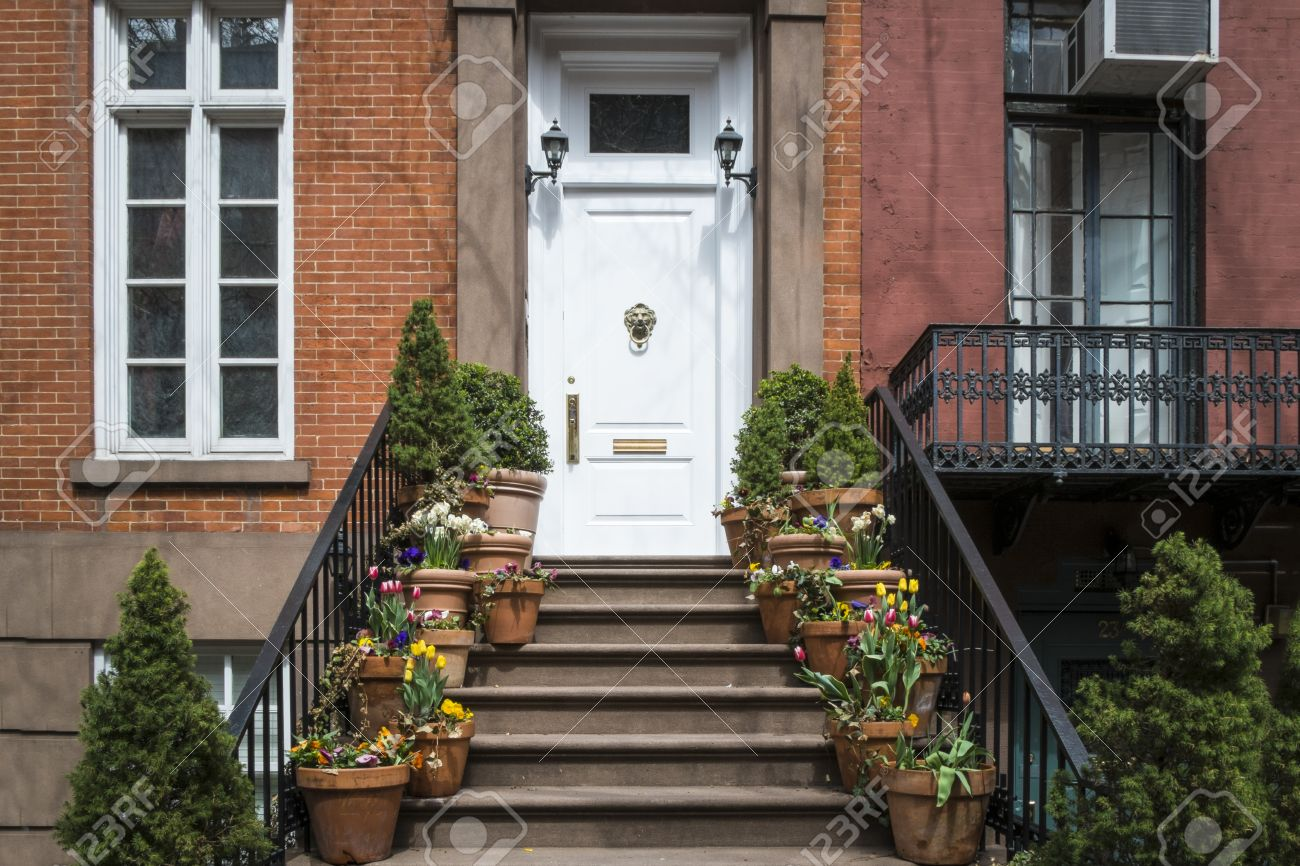 City Apartment Building Entrance entrance to greenwich village apartment with flowerpots on steps