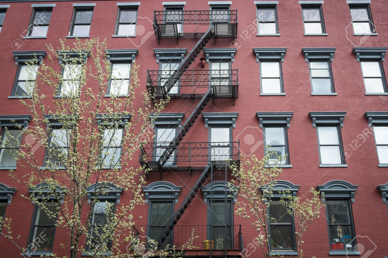 Brick Apartment Building old red brick apartment building in new york city stock photo