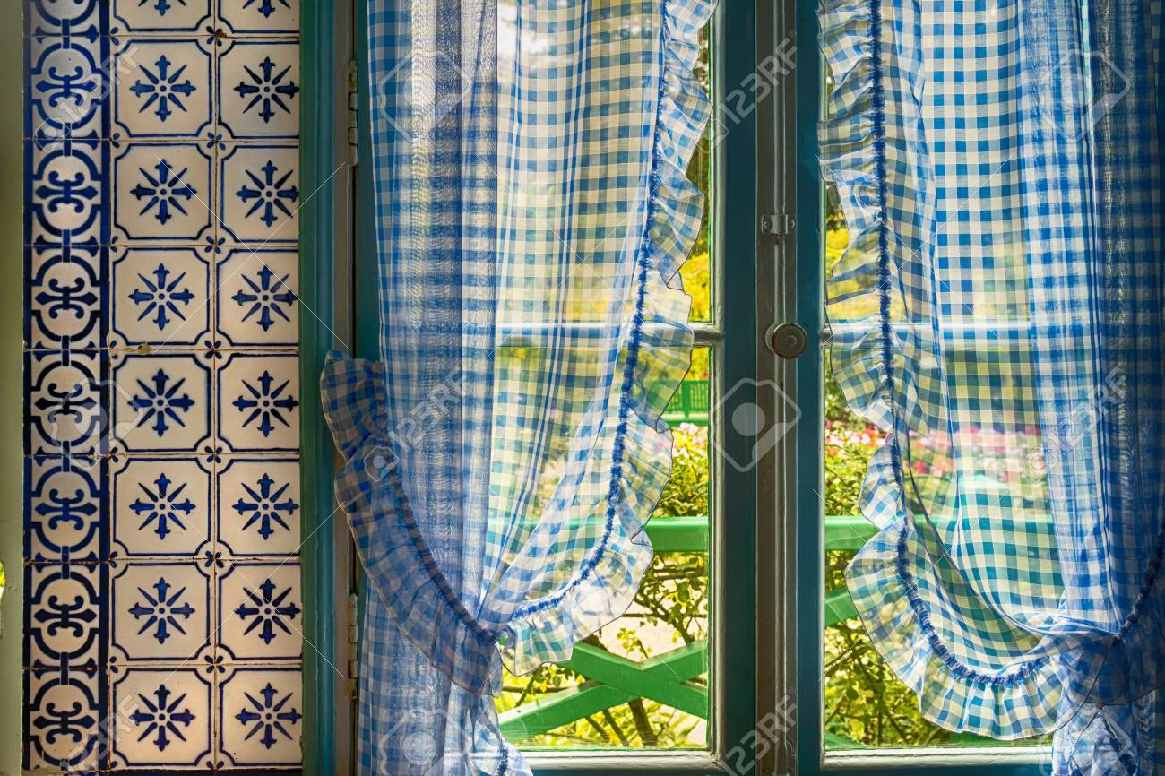 Blue Checkered Curtains And Tile In Monets Kitchen Giverny France Stock Photo