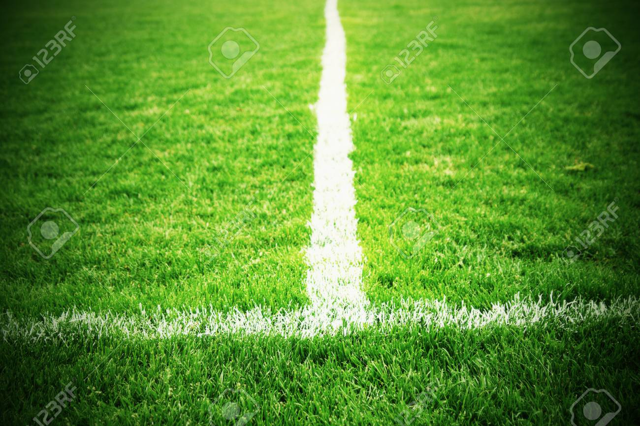 Cross Of Painted White Lines On Natural Football Grass Artificial