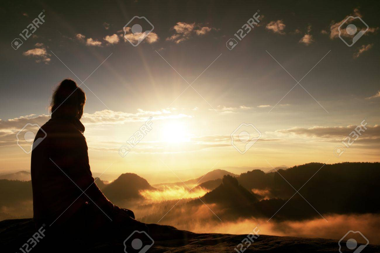 Beautiful young woman tourist enjoy daybreak on the sharp corner of sandstone rock and watch over valley to Sun. - 48101194